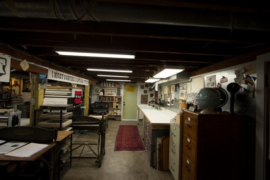 The basement shop of Jeff Shay, well lit with 5000K, 92 CRI fluorescent tubes, which provide both task and general lighting depending on the fixtures' quantity and location.