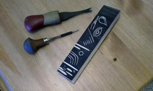 Testing a wood block for woodcuts