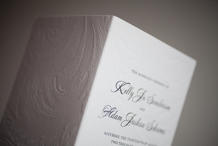 blind deboss and classic black letterpress wedding programs