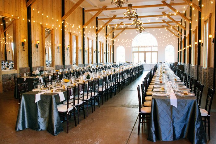 Instead of a lot of round tables, Jennifer and John opted for 3 dramatically long tables to create a sense of community and warmth