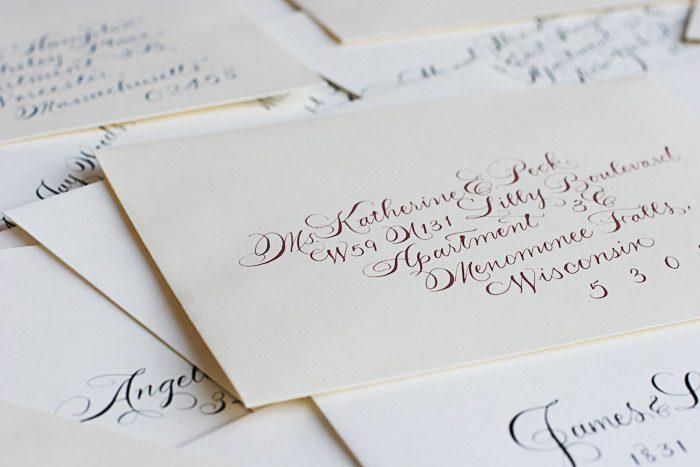 Colored inks used are used to calligraph envelopes for less formal events -- black ink should be used for formal affairs