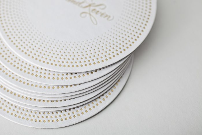 Foil stamped coasters from Bella Figura, featuring the Champagne design, printed on 100% recycled coaster stock