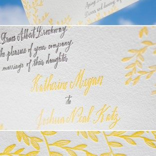 This wedding invitation customization of Bella Figura's Gramercy design is letterpressed in pewter and yolk inks.