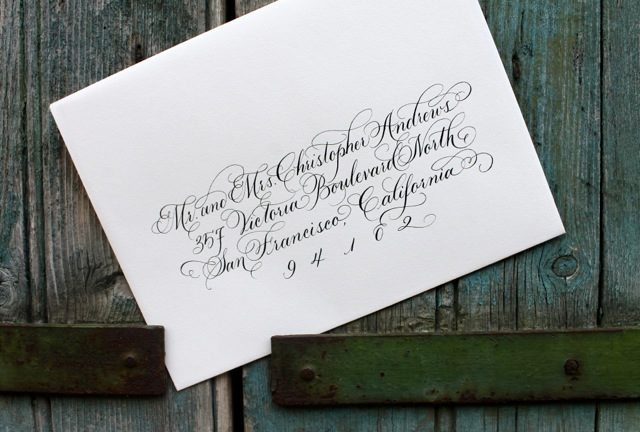 Calligraphed envelopes from Bella Figura calligrapher Sarah Hanna, featuring her Embellished Victoria hand
