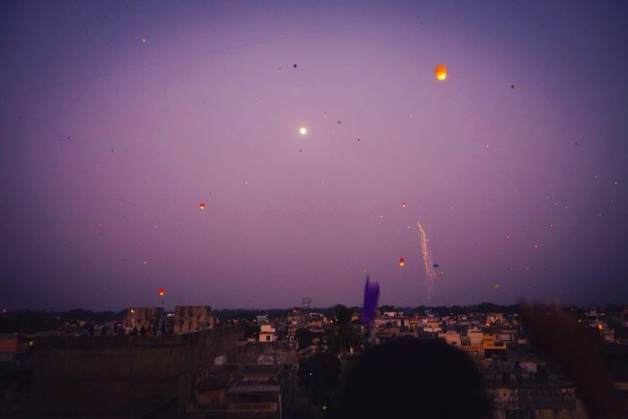 Lanterns and kites floating into the sky during the Uttarayan International Kite Festival in Gujarat, India