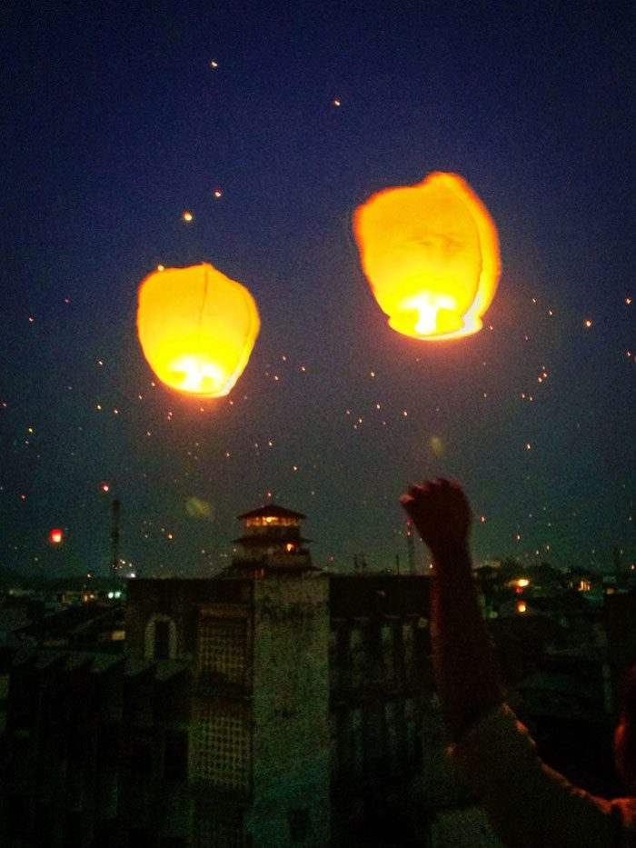 Lanterns floating into the sky during the Uttarayan International Kite Festival in Gujarat, India