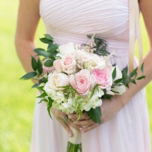 Pale pink Donna Morgan bridesmaid dress