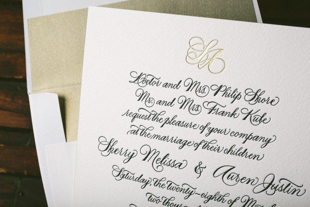 Hand calligraphed black and gold wedding invitations   Bella Figura