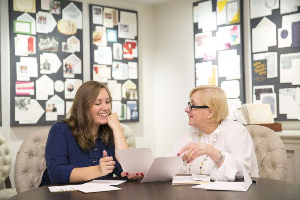 Bella Figura flagship store manager Linda Hays with a Bella Figura bride