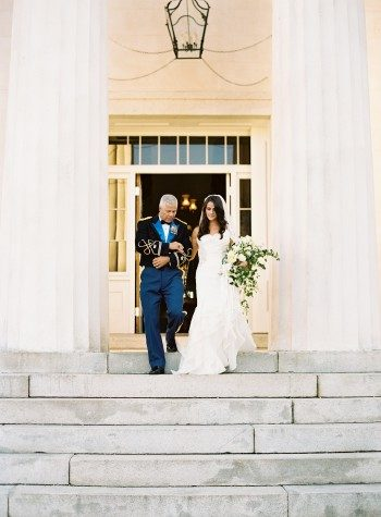 A Bella Figura bride is escorted down the aisle by her father at Berry Hill Resort in Virginia