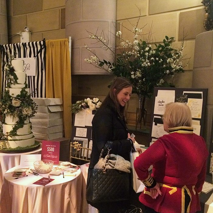 Bella Figura flagship store manager Linda Hays chats with a bride at the 2016 Martha Stewart Wedding Party