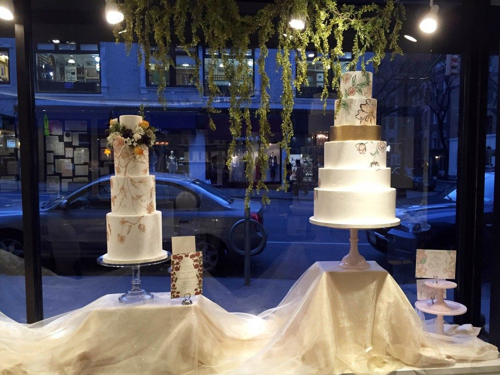 Invitation-inspired wedding cake window display at the Bella Figura flagship store - created by Madison Lee's Cakes