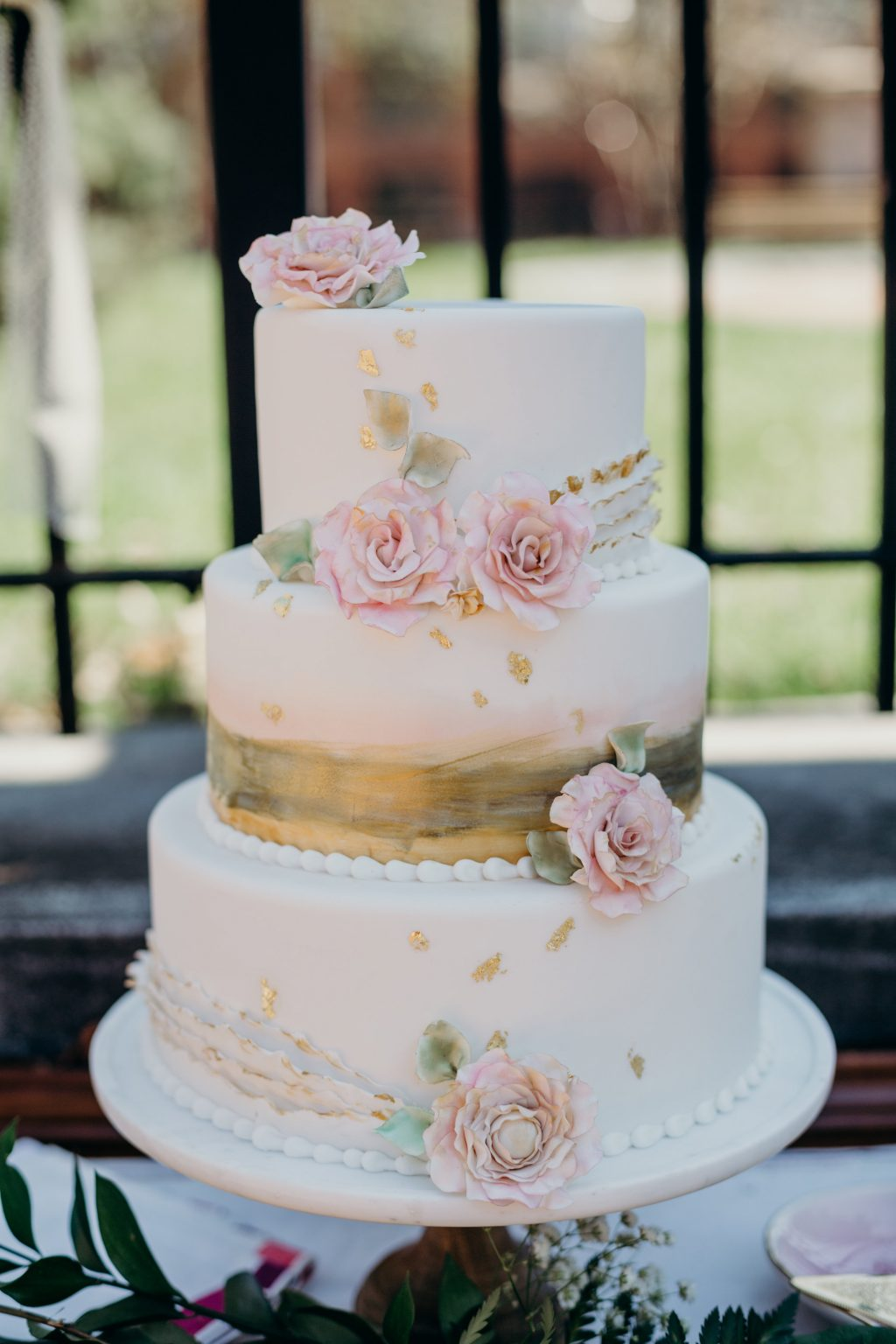 Romantic blush floral wedding cake | summer wedding inspiration shoot in downtown Syracuse featuring Bella Figura wedding invitations | Photos by Nicole Lagoe Photography