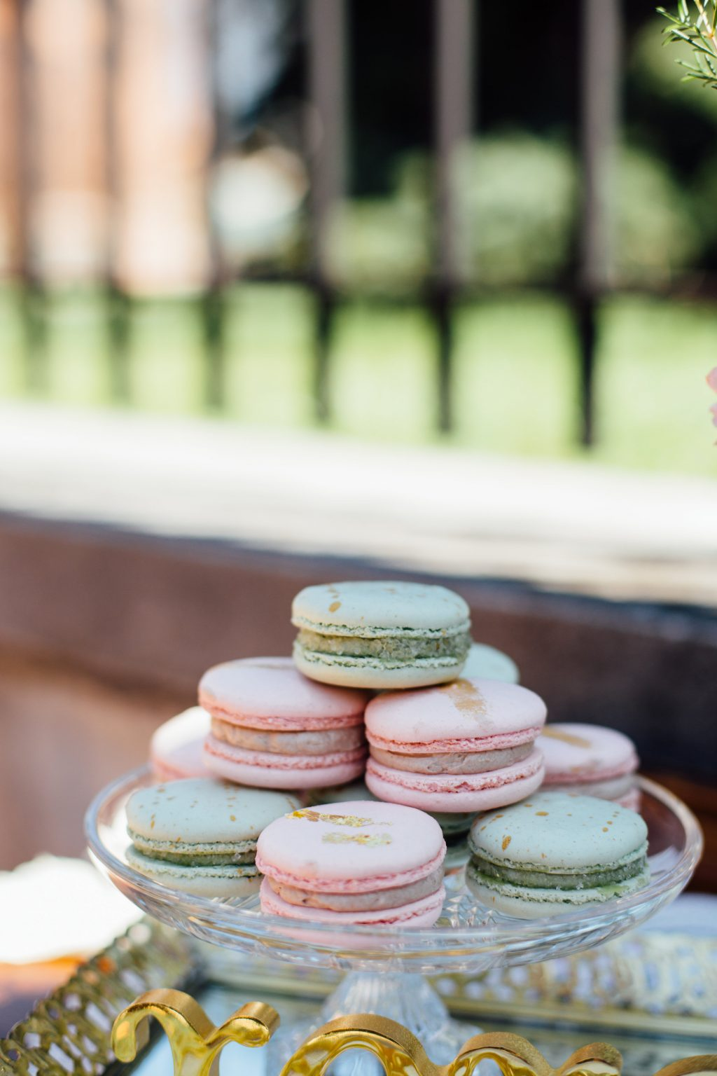 Pastel macarons at a summer wedding inspiration shoot in downtown Syracuse featuring Bella Figura wedding invitations | Photos by Nicole Lagoe Photography