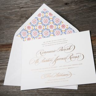 Our Morocco design carries the same kind of horizontal orientation as Harry and Meghan's with the traditional etiquette written across the page. It features Partial Flourish hand calligraphy accents by Ted Clausen on the names of the bride and groom as well as their venue. For an extra touch of luxury, the entire design is printed in our Copper Matte foil. If you're after a formal, classic invitation, look no further!