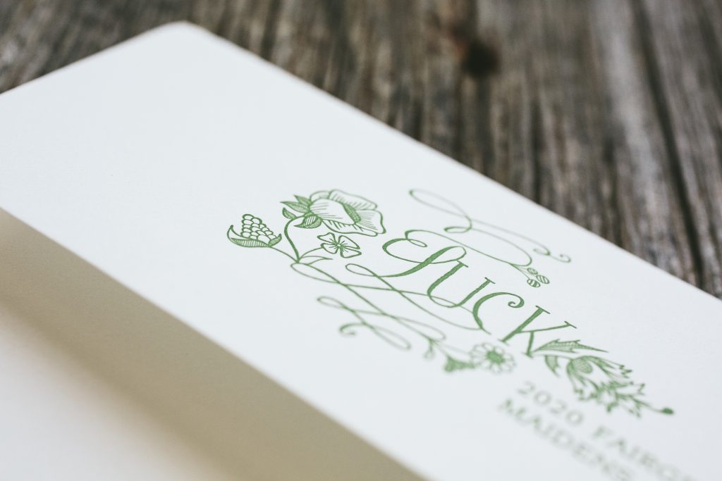 floral letterpress invitations in garden