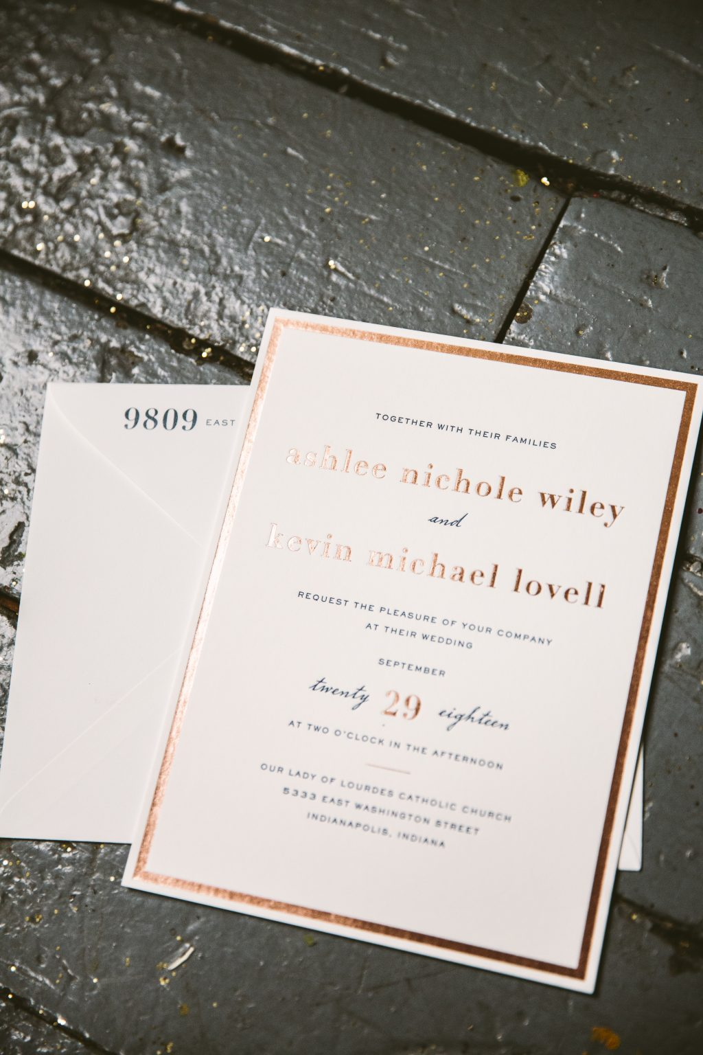 Rose gold wedding invitations with navy touches