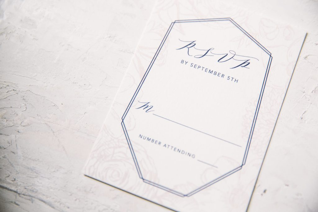 Floral blush and navy wedding invitation