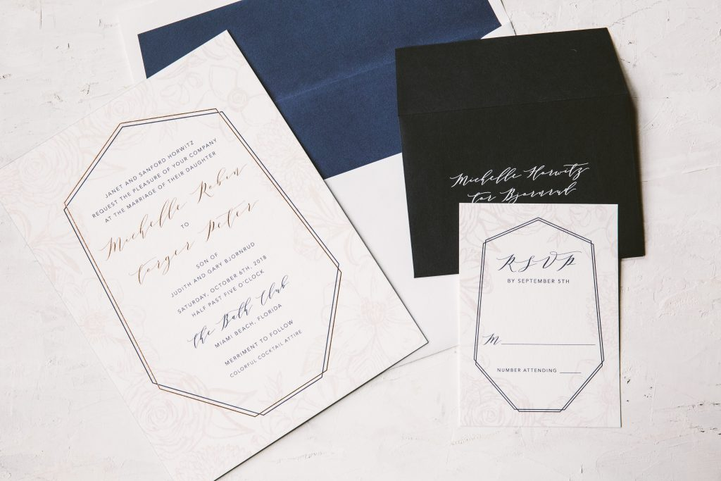 Floral blush and navy wedding invitation