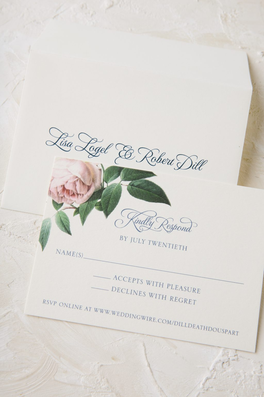 Navy letterpress and floral wedding invitations