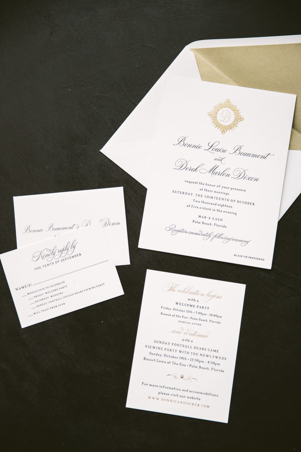 Black letterpress invitations with gold foil accents