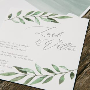 Watercolor wedding invitations with botanical accents