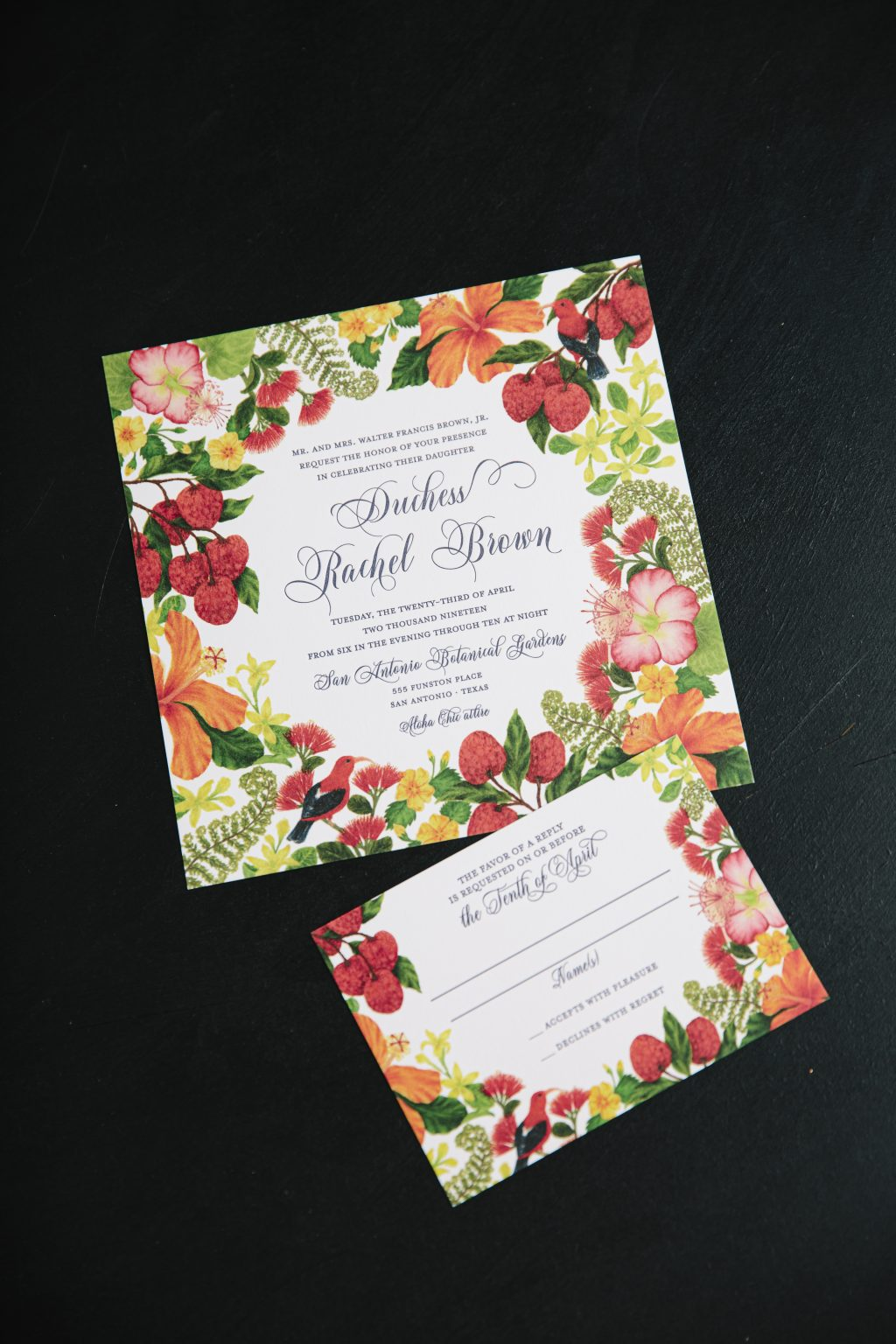 Colorful letterpress invitations with tropical florals