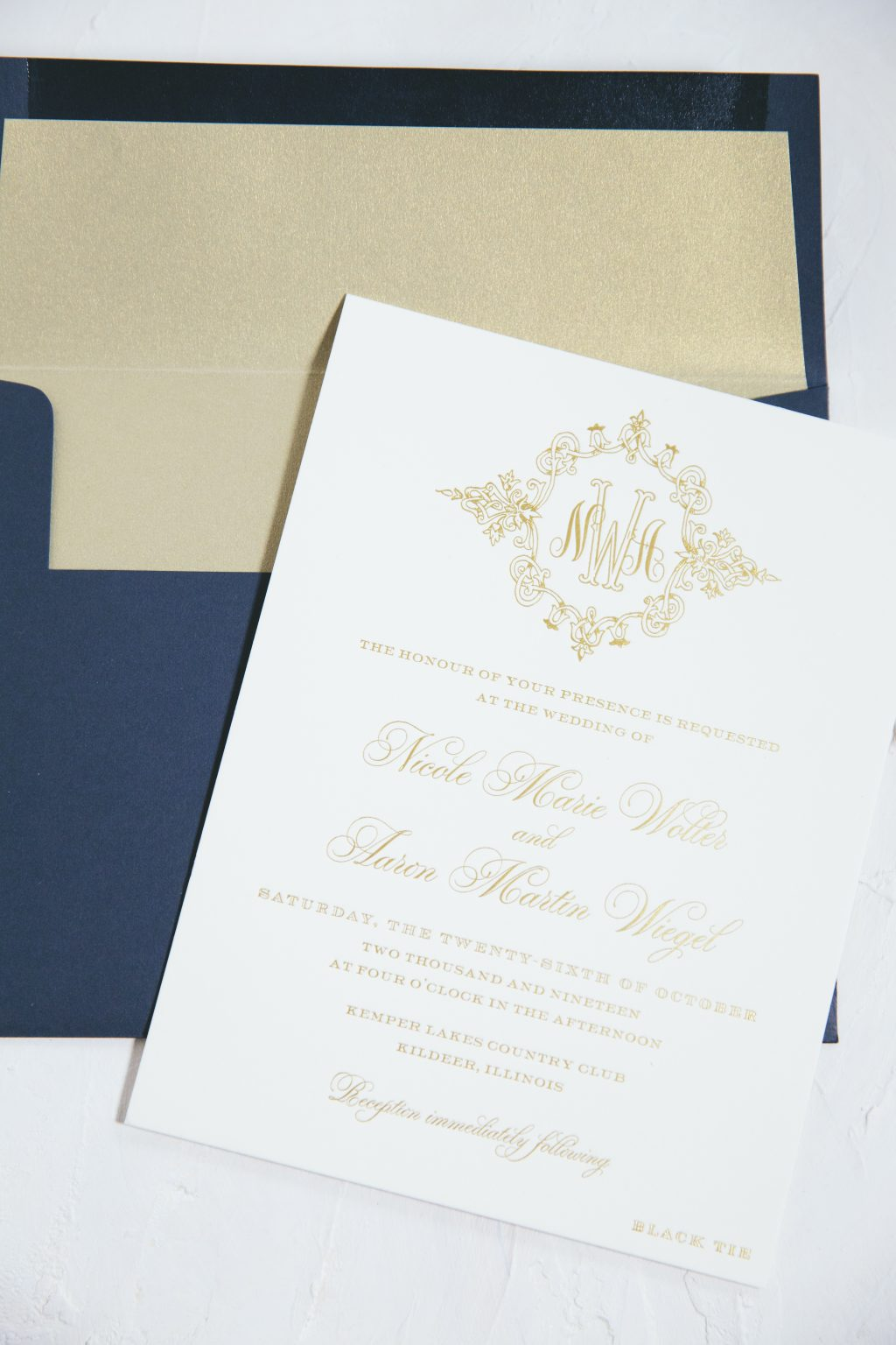 Gold monogrammed wedding invitations