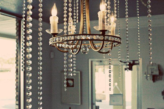 An elegant chandelier hangs in the Urban coast Shop