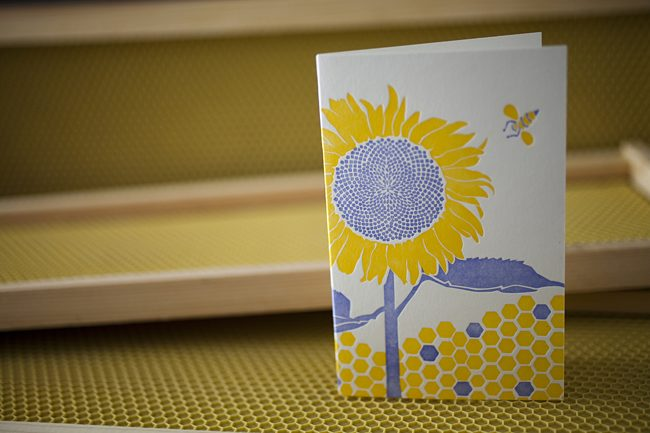 Smock's Sunflower card, part of the line's change the world card series, helps the Pesticide Action Network save the honeybees.