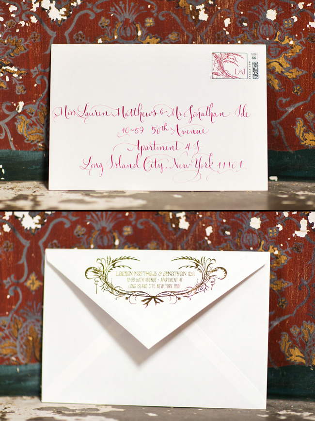Letterpress wedding invitation envelopes with custom stamps and hand calligraphy addressing