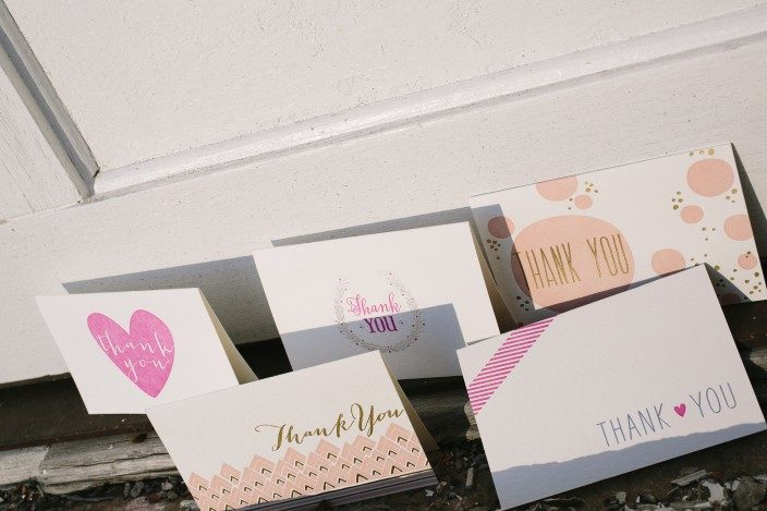 Letterpress and foil stamped thank you notes from Smock in shades of pink with silver and gold foil accents
