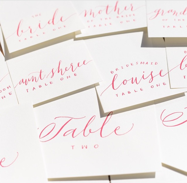 Hand calligraphed place cards + table numbers