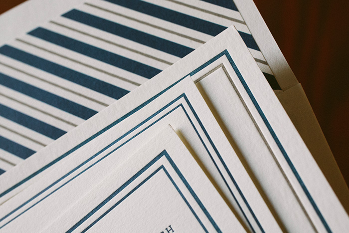 Striped envelope liners + letterpress invitations by Smock