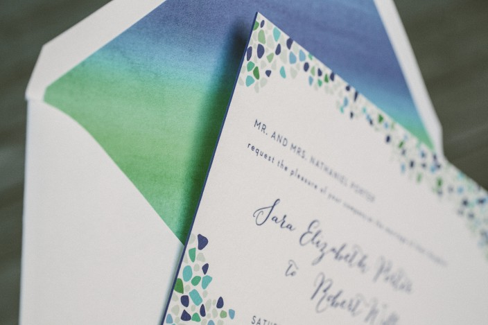 Custom sea glass inspired wedding invitations from Smock with custom watercolor envelope liners
