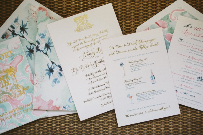 Gold foil stamped wedding invitations with tropical invitation sleeves and accessory pieces