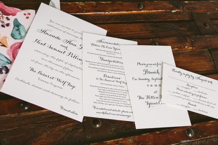 Custom letterpress wedding invitation suite  + floral watercolor invitation sleeves from Smock