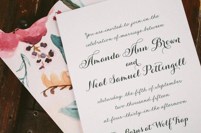 Custom letterpress wedding invitations  + floral watercolor invitation sleeves from Smock