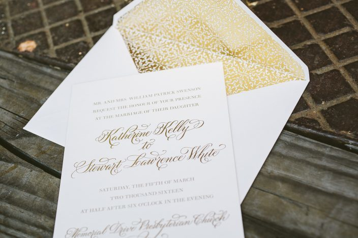 Elegant gold calligraphy wedding invitations with foil liners