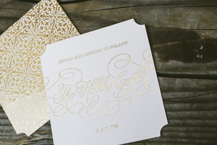 Gold foil stamped reception card from Smock with patterned backing