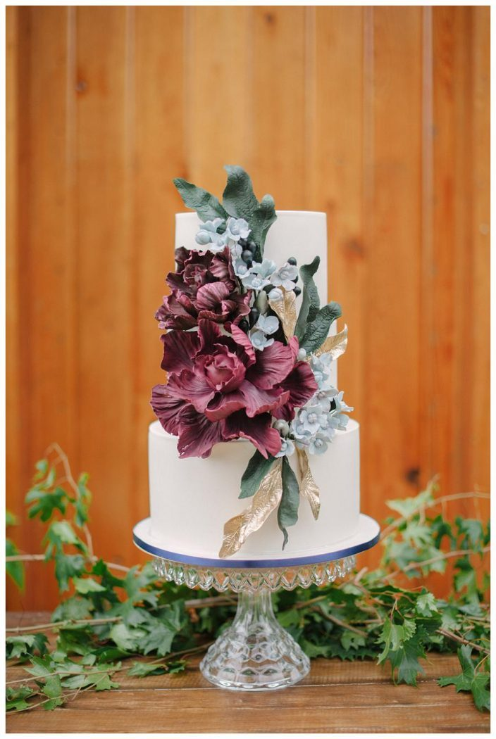 Modern wedding cake with marsala sugar flower details