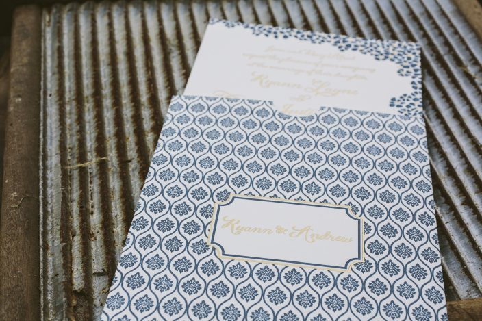 Custom gold + navy wedding invitations and sleeves from Smock