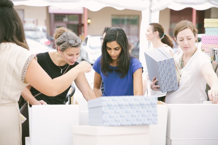 Shoppers stocking up on product at the 2016 Smock Sidewalk Sale