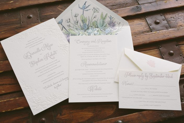 Elegant garden inspired wedding invitations featuring blind embossing and blind debossing