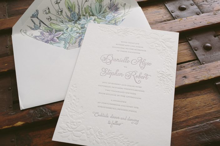 Elegant garden inspired custom wedding invitations featuring blind embossing and blind debossing