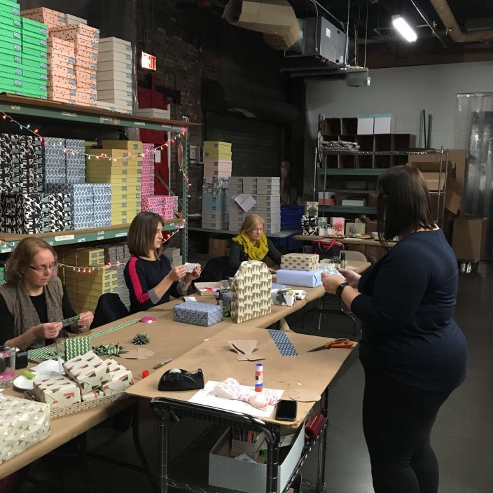 Smock's Jen DeRoberts teaching gift wrapping workshop attendees how to make gift toppers at a gift wrapping workshop