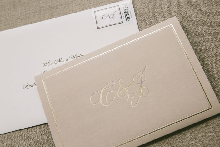 Custom pocketfold monogrammed wedding invitations with matching monogram postage stamp
