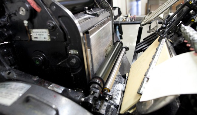 photo of Paper feeding through press