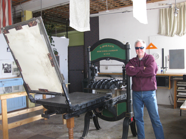 James Jareb in front of his beautiful R. Hoe hand press.