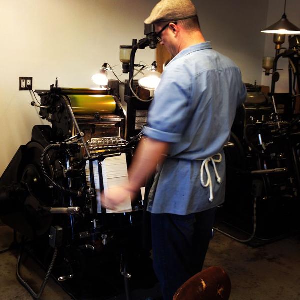 Ken, of Fugu Fugu Press, hard at work printing on their Heidelberg Windmill.